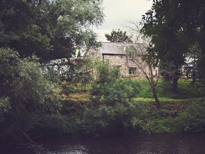 A view towards the cottage from the other side of the river bank