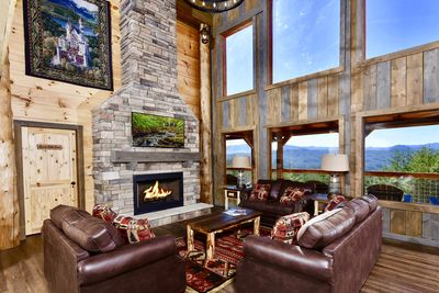 The main floor has a large 2 story great room with a massive fireplace and TV