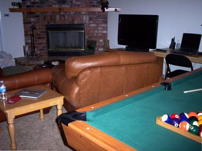 Another view of the living room with the pool table.