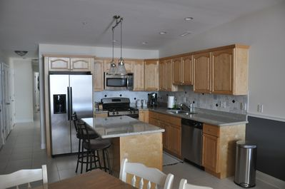 Kitchen- fully stocked with granite countertops and stainless appliances
