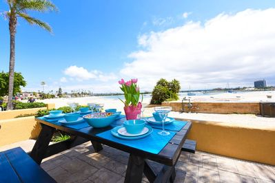 """Dine outside on the patio and enjoy the spectacular view. Picnic table seats 6 people. Melamine outdoor dishes included. """"The location is amazing, and we loved being right on the beach."""" - Oystein (guest)"""