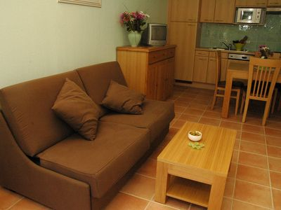 Photo for Groundfloor Apartment with private garden and terrace. 2 Outdoor Pools
