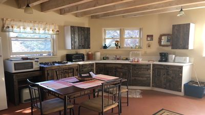 Spacious kitchen with 4 burner gas stove, microwave, toaster, electric kettle.