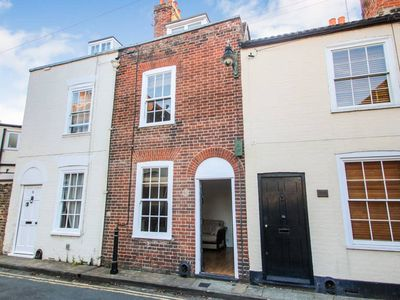Photo for Quaint grade two listed cottage right in the city centre on quiet road
