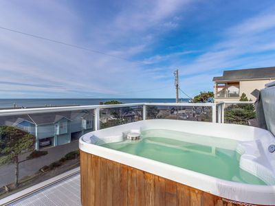 Photo for Luxury home w/game room & hot tub overlooking the beach!
