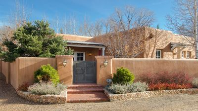 Photo for HISTORIC EAST SIDE ~ Warm and Inviting all New Furnishings, Walk to canyon road.