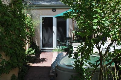 Your own private garden entry with hot tub!