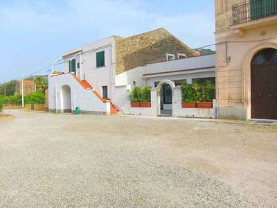 Photo for Old farm just 100 meters from the sea with a terrace for your book and your wine