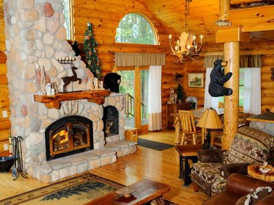 Photo for Relaxing lake side log cabin with amazing views and complete amenities.