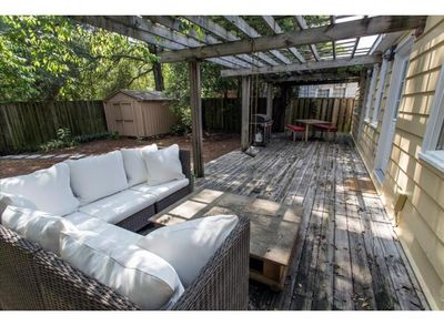 Back Deck with sitting area, grill and table.