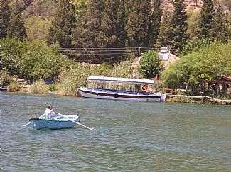 Take the rowing boat to Caunos