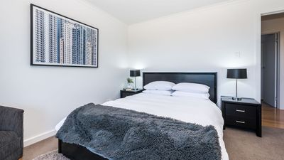 Bedroom 2 has Queen bed and is located opposite the main bathroom on lower level