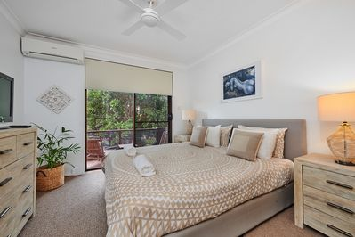 The master bedroom with balcony and ensuite