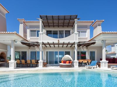 Photo for Beach front four bedroom villa located a few minutes walk from Julia beach in Vale do Lobo. Stunning sea views. J121