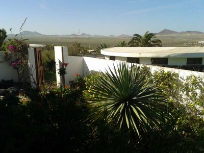 Photo for Bungalow BOZHOM in Famara for 3 persons with terrace, garden, views to the ocean, views of the volcanoes, WIFI and less than 200m to the sea