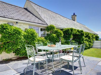 Photo for Gorwel is a traditional long house set within two acres of grounds, half a mile from the sea and ben
