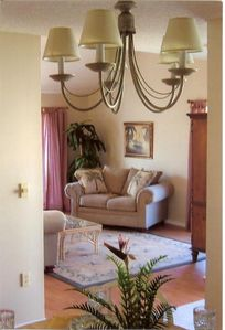 Take a look at our comfy livingroom w/cathedral ceiling, balcony access & view