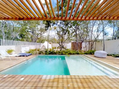 Photo for NEW LISTING! Secluded two-bedroom w/ jetted tub & shared pool, grill, yard