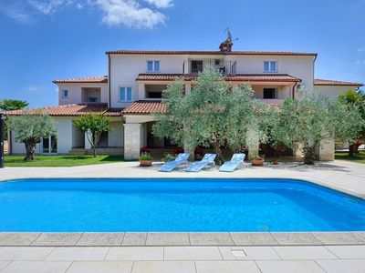 Photo for Nice furnished apartment with covered terrace, located in front of the pool
