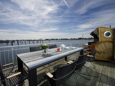 Photo for Exclusive beach house with four terraces, all-round water view, sauna, whirlpool and fireplace in the Baltic Sea resort of Olpenitz to Schlei and Baltic Sea.