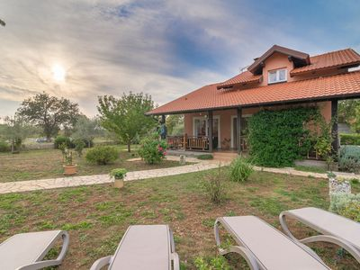 Photo for Lovely holiday home with beautiful garden, big roofed terrace, 12km from Zadar