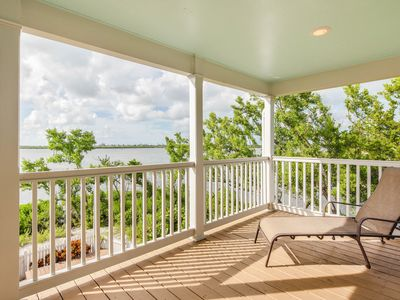 Photo for NEW LISTING! Waterfront townhouse w/ pool, fenced backyard &  deck - dogs ok