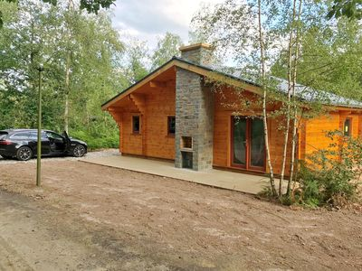 Photo for Modern, wooden chalet with dishwasher, located in the forest