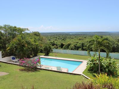 Photo for Stunning views of the Caribbean Sea, beautiful inground pool!