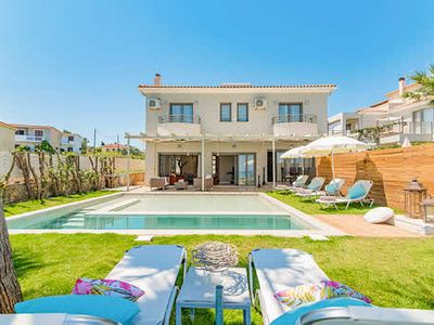 Photo for Stunning 3 bedroom, sea front located villa, high quality furnishings with a uniquely styled swimming pool.