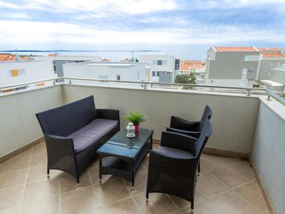 Photo for Two bedroom apartment with terrace and sea view Novalja (Pag) (A-17144-d)