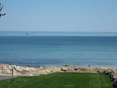 A view from the deck looking over the lawn onto the beach