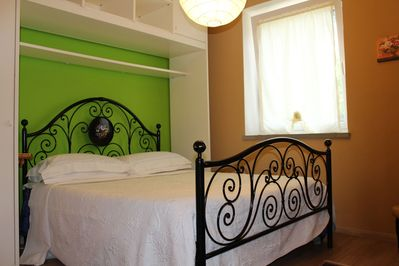 Large bedroom, with views of garden