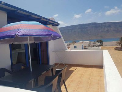 Photo for Apartment MYHY in Caleta de Sebo for 4 persons with terrace, balcony, views to the ocean, views of the volcanoes, WIFI on the go and less than 200m to the sea