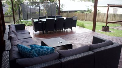 Relax on the back deck while the kids jump on the tramp