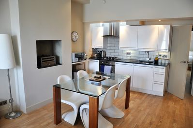 Well equipped kitchen and dining area.