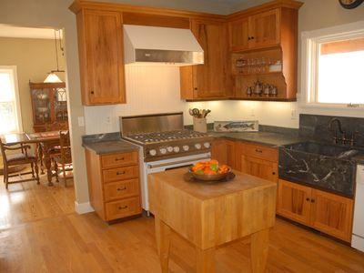 Viking range and soapstone countertops with country sink