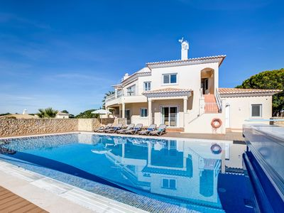 Photo for Fabulous 3 bedroom villa with solar heated pool and sea views