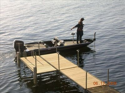 Dock with boat bumpers and ladder to access Lake Champlain