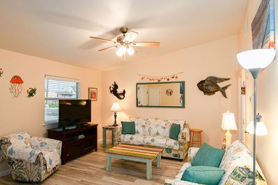 Living Room - Welcome to Port Aransas! This condo is professionally managed by TurnKey Vacation Rentals.