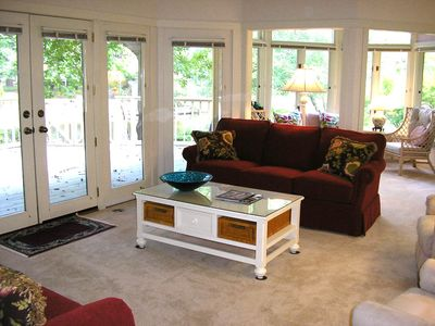 Spacious living room - new carpet, sofa, coffee table; awesome view to deck/pond