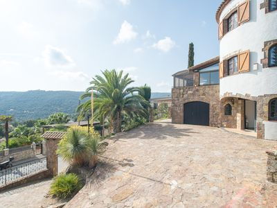 Photo for Unwind in this modern Spanish house nestled in the hillside of Calonge