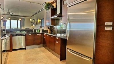 Stainless steel appliances and ocean view for chef