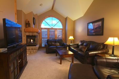 Main level living room.  Leather couches, 52 HDTV, gas fireplace, hardwood floor