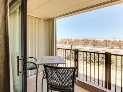 Photo for Cozy oceanfront condo with beach views and easy access