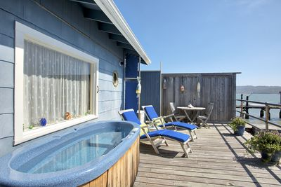 Private bayfront deck with hot tub and lounge chairs