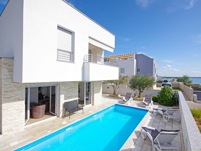 Photo for Apartment 20 sqm directly on the sea with heated pool and motor boat 115 hp