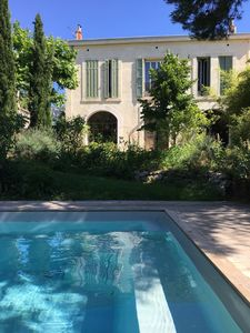 Photo for Beautiful Provencal house with swimming pool 150 meters from the beach, residential.