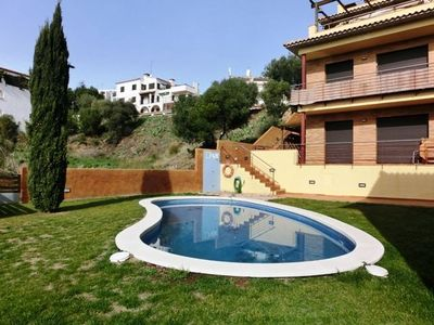 Photo for Holiday apartment located in a residential building with pool, just 500 meters away from h