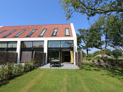 Photo for Duinhuis 11 modern holiday villa right at the North Sea dunes