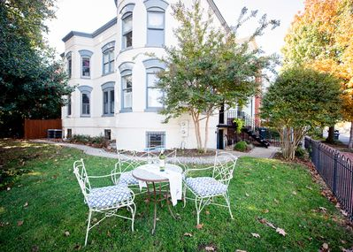 Relax outdoors with a glass of wine or cup of coffee. Apt. entrance below porch